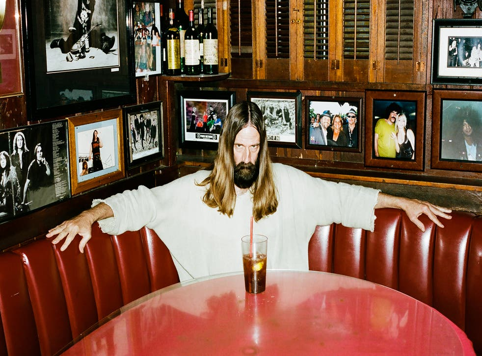 Hollywood Jesus enjoys a well-earned beverage in a Los Angeles bar (Photo: Roo Lewis)
