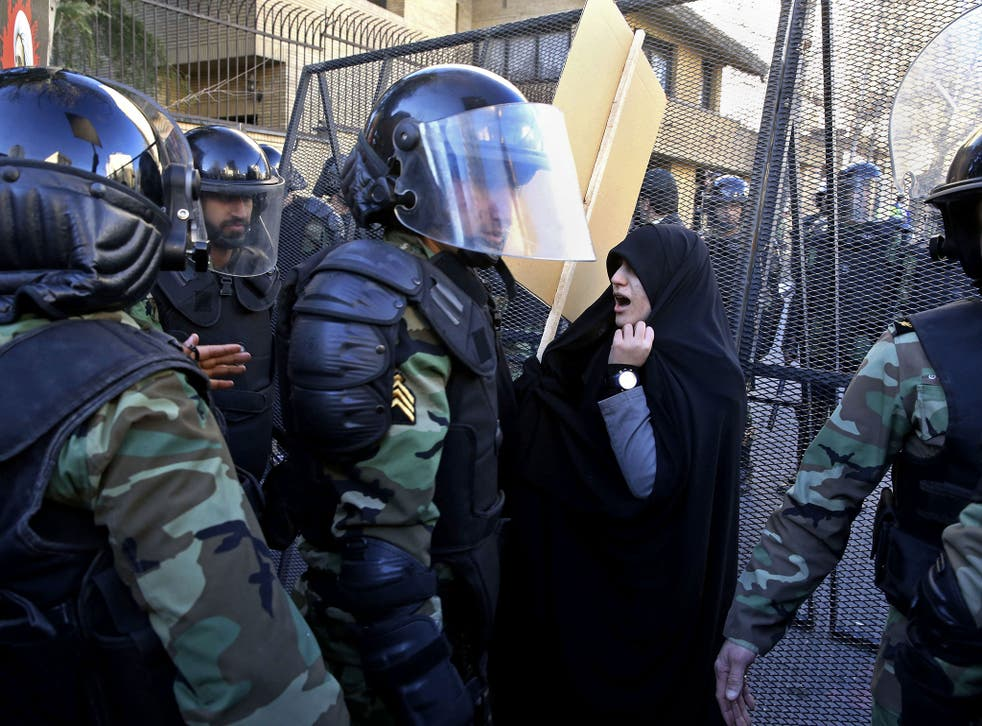 Police officers try to disperse protesters in front of the Saudi Embassy in Tehran, Iran, Sunday, Jan. 3, 2016