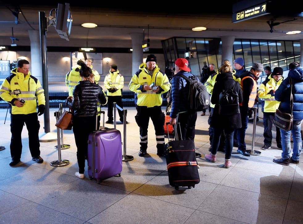 Security staff check passengers' documents at Kastrups railway station outside Copenhagen. Some 17,000 commuters cross between Malmo in Sweden and the Danish capital every day