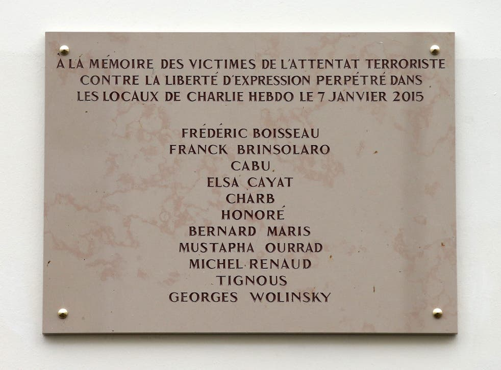 A commemorative plaque to pay tribute to the victims of 2015's attacks outside the former offices of French weekly satirical newspaper Charlie Hebdo