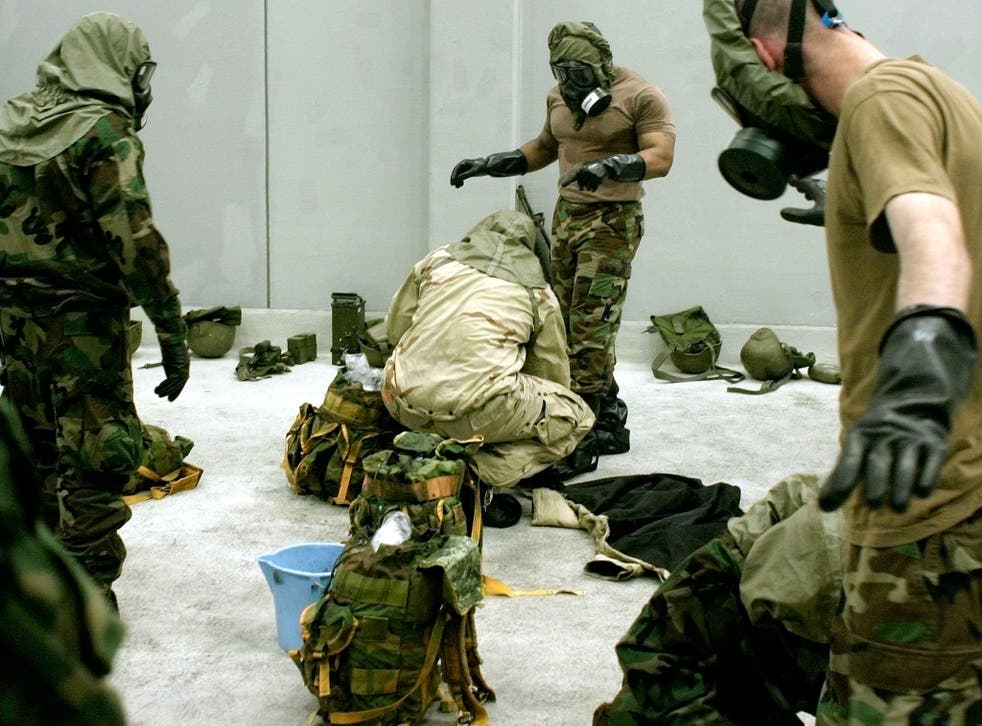 File: US forces practice safety protocols in event of a chemical weapons attack