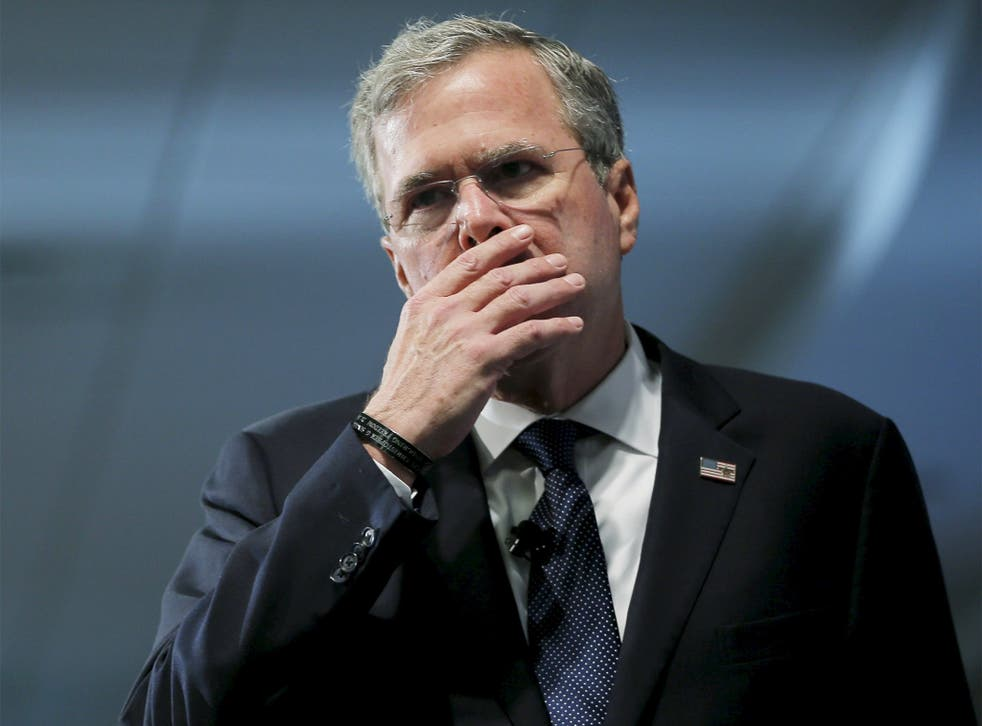 Jeb Bush pauses while speaking about his daughter at the New Hampshire forum on drug addiction