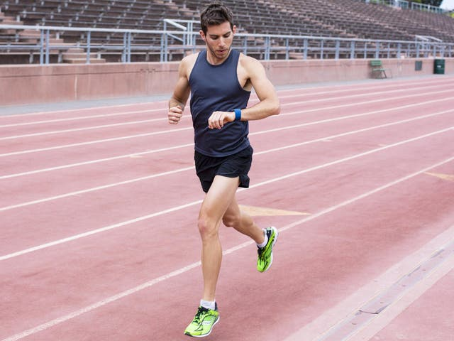 Fitness trackers monitor your steps around the running track