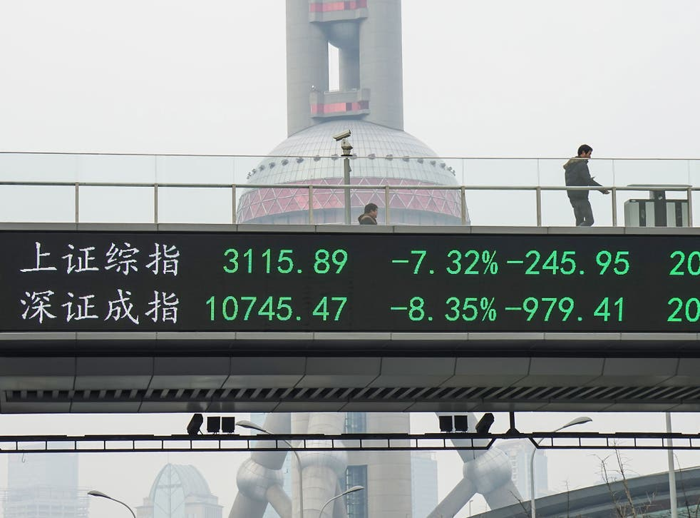 A man passes by electric screen showing Chinese shares decreases sharply to a halt point on January 7, 2016 in Shanghai, China. Chinese shares slumped to a halt in half an hour on Thursday which was the second halt in the four trading days of 2016.