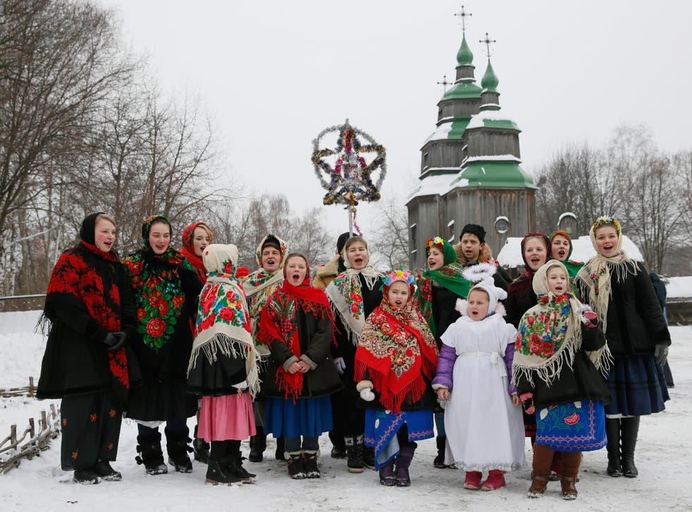 People dressed in traditional costumes sing Christmas carols in Kiev