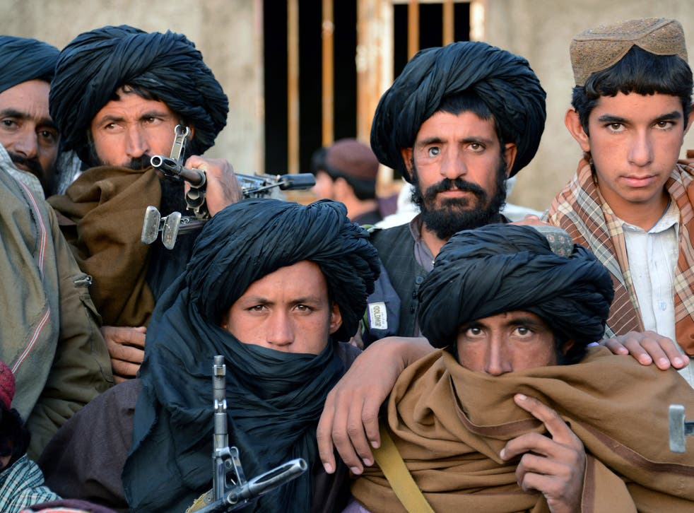 Afghan fighters belonging to a breakaway faction of the Taliban gather at Bakwah in the western province of Farah in November; China wants the rift healed so it can work with the group
