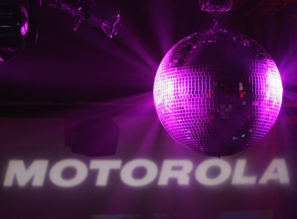 A disco ball shines inside the Music Box Theatre where Motorola hosted their sixth anniversary party