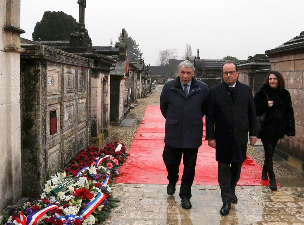 French President Francois Hollande (C), Gilbert Mitterrand (L) and Mazarine Pingeot arrive at the cemetery to attend a ceremony marking the 20th anniversary of the death of former French President Francois Mitterrand in Jarnac, France