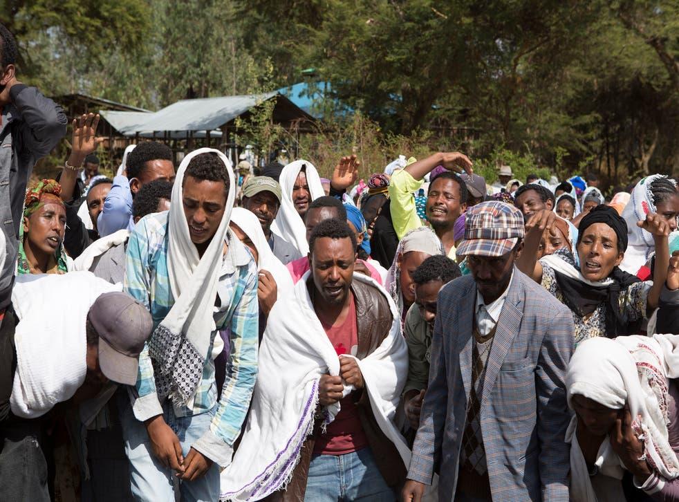 People mourn Dinka Chala's death in Yubdo Village.
