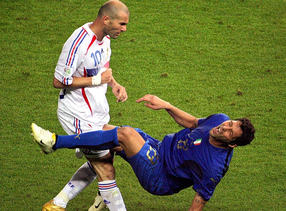 Zinedine Zidane (left), who is 'not a nice guy' according to former France coach Raymond Domenech,  fells Italy's Marco Materazzi with a headbutt in the 2006 World Cup final