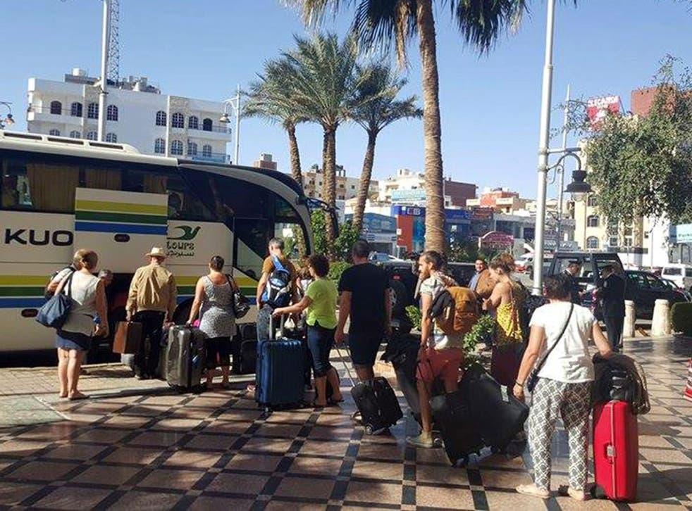 Tourists leave the Bella Vista Hotel following the attack