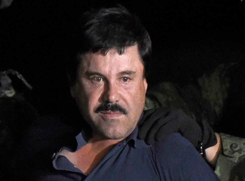 Drug kingpin Joaquin 'El Chapo' Guzman is escorted into a helicopter following his recapture