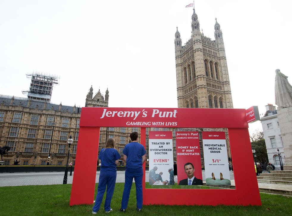 Campaigners for the junior doctors' cause set up a fake betting shop frontage outside Parliament