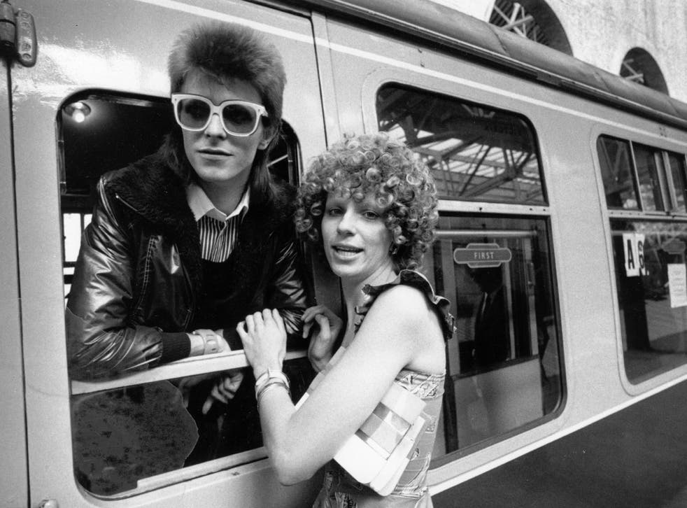 9 July 1973: Pop singer David Bowie is seen off at the station by his wife Angie