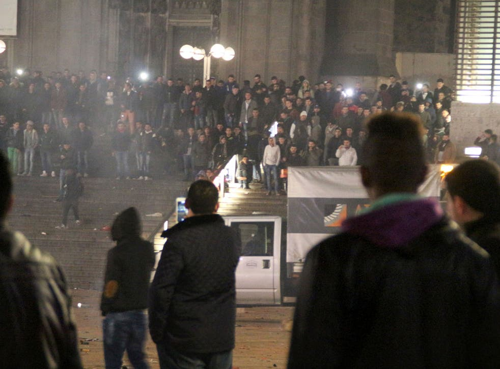 Picture taken on 31 December, 2015 shows people gathering in front of the main railway station in Cologne