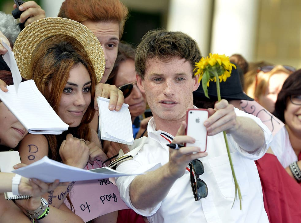 Eddie Redmayne with fans at the Giffoni Film Festival, Italy in 2013. The actor tried to live without his iPhone as he felt it had become too great a distraction