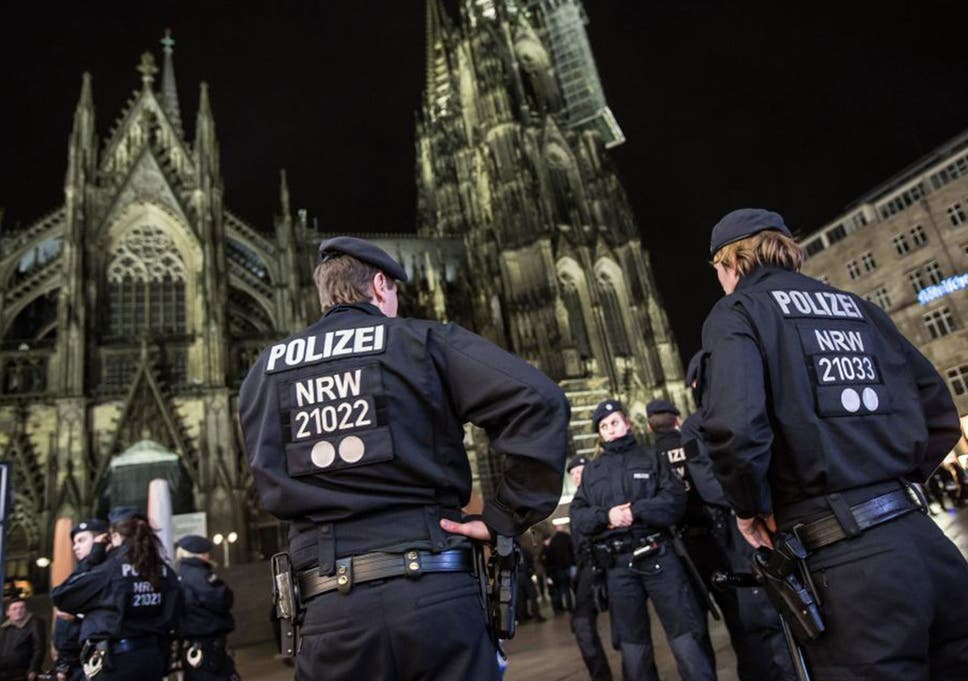 wholesale dealer 96c68 65174 Police guard the area around the cathedral in Cologne after reports of  attacks on men of