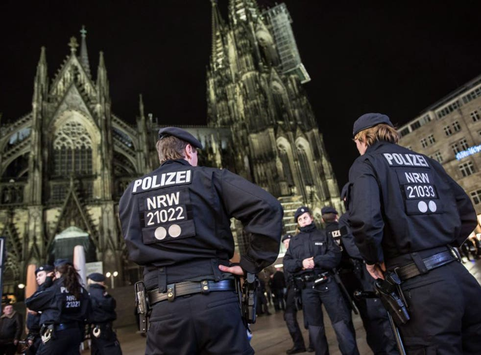 Police guard the area around the cathedral in Cologne after reports of attacks on men of North African or Arab appearance, in retaliation for the New Year's Eve sex assaults