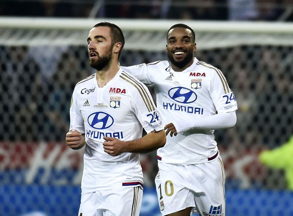 Alexandre Lacazette, right, has been strongly linked with a move from Lyon to Newcastle