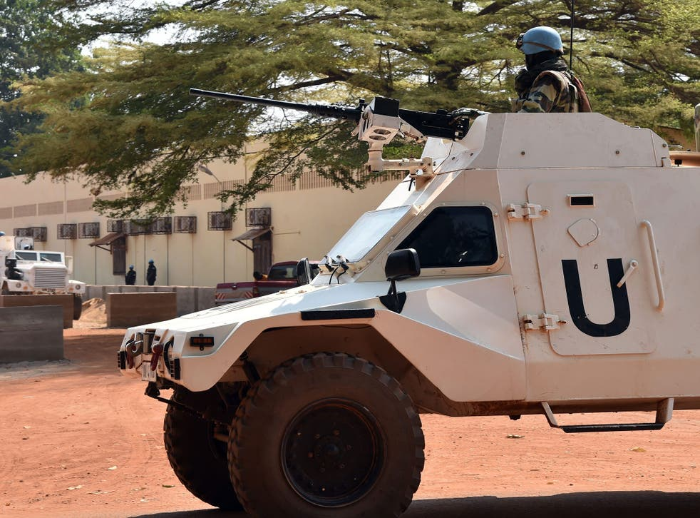UN peacekeepers patrol outside a vote-counting centre for elections in Bangui