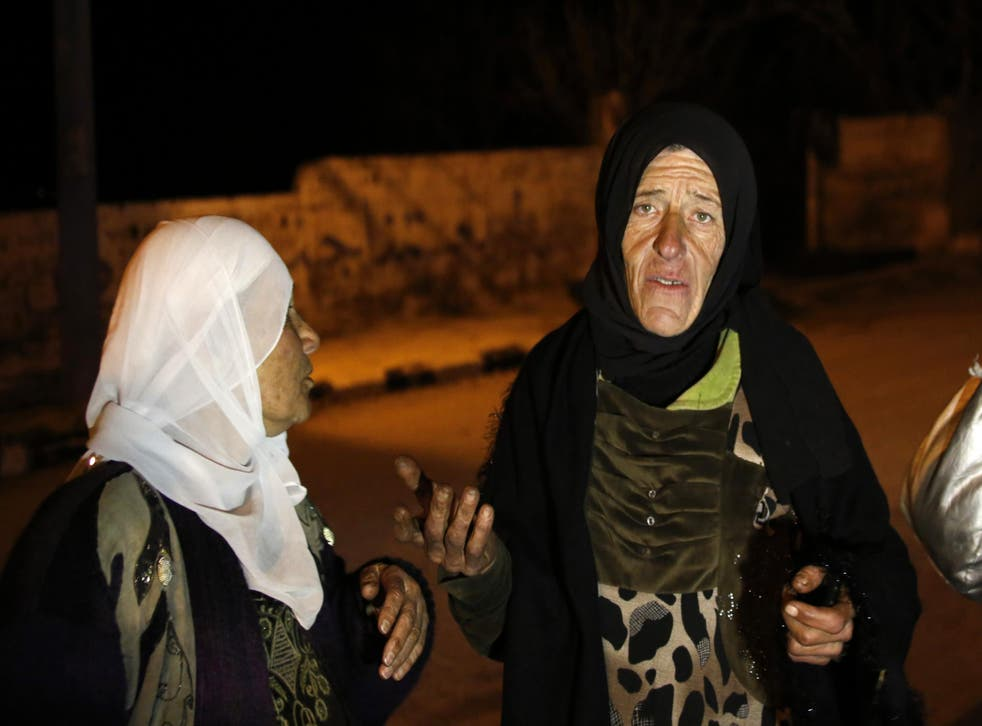 Residents talk to reporters in the besieged town of Madaya, northwest of Damascus, Syria