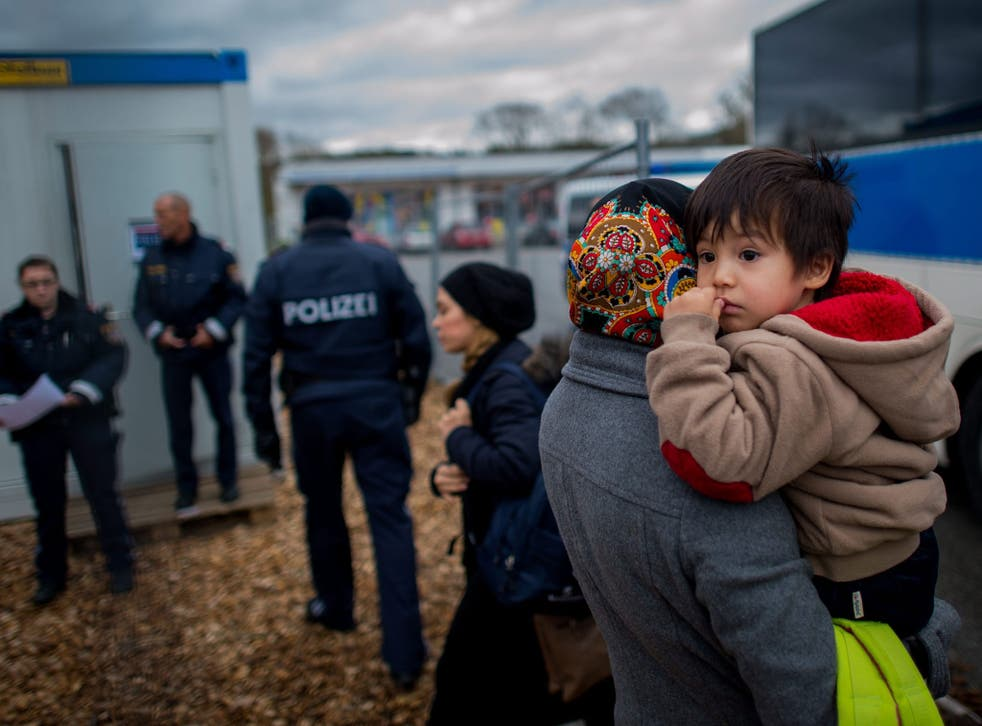 Migrants arrive at a temporary camp after German officials sent them back to Austria in Schaerding Am Inn, Austria, 12 January 2016.