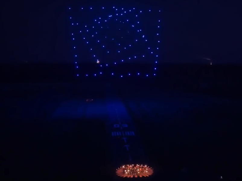 Orchestra accompanied by stunning drone light display sets