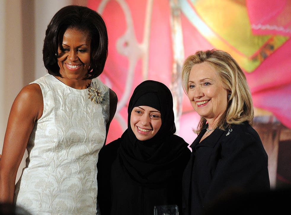 Samar Badawi receives the 2012 International Women of Courage Award from Michelle Obama and Hillary Clinton