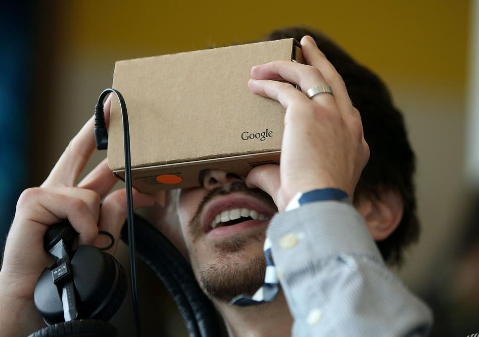 69b98eee42b4 A man tries out the Google Cardboard VR headset at the 2015 Google I O