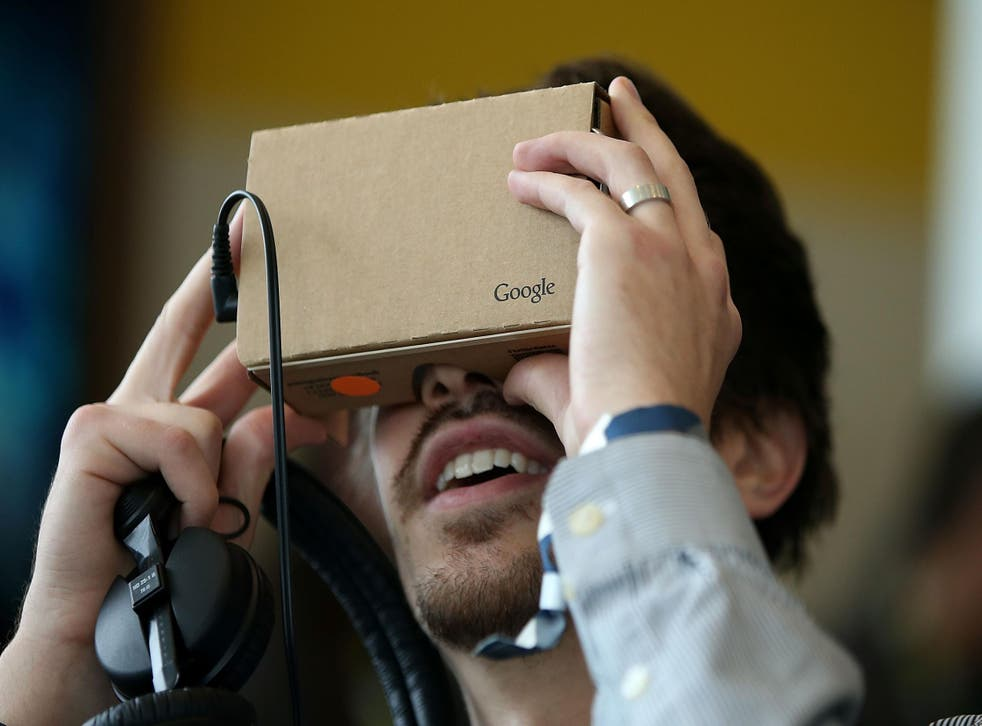 A man tries out the Google Cardboard VR headset at the 2015 Google I/O conference in San Francisco