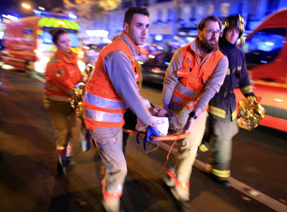 Terror threat: An injured woman is taken from the Bataclan Theatre after the shootings in Paris on 13 November last year