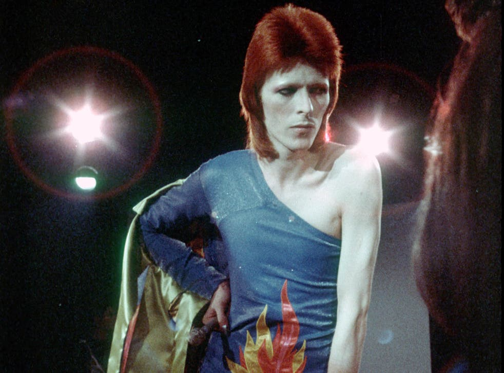 David Bowie performs onstage during his 'Ziggy Stardust' era in 1973 in Los Angeles, California