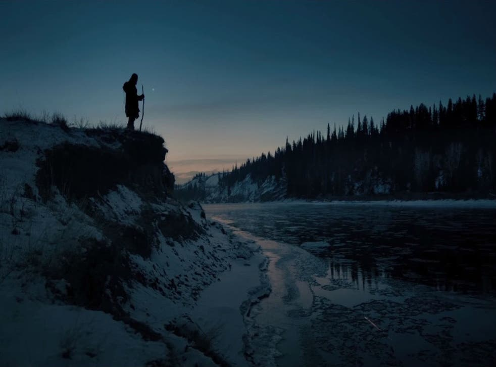 Leonardo DiCaprio stands atop a mountain in front of Emmanuel Lubezki's camera in The Revenant