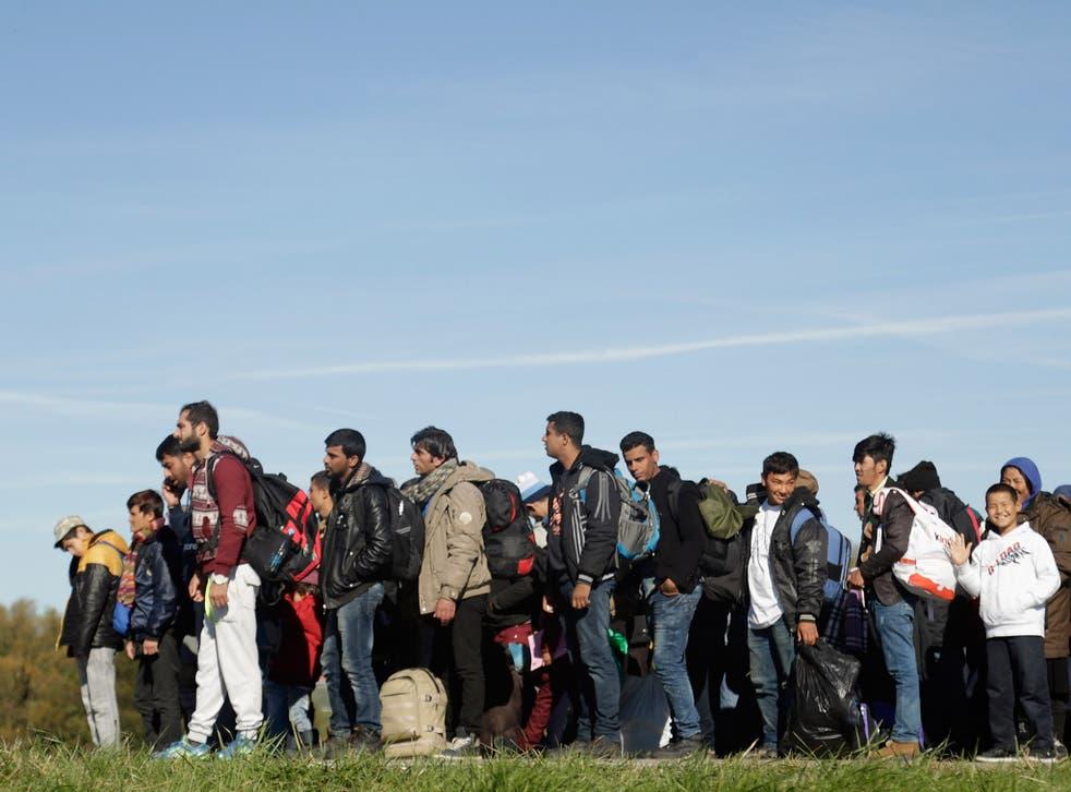 Migrants arrive at the German border to Austria