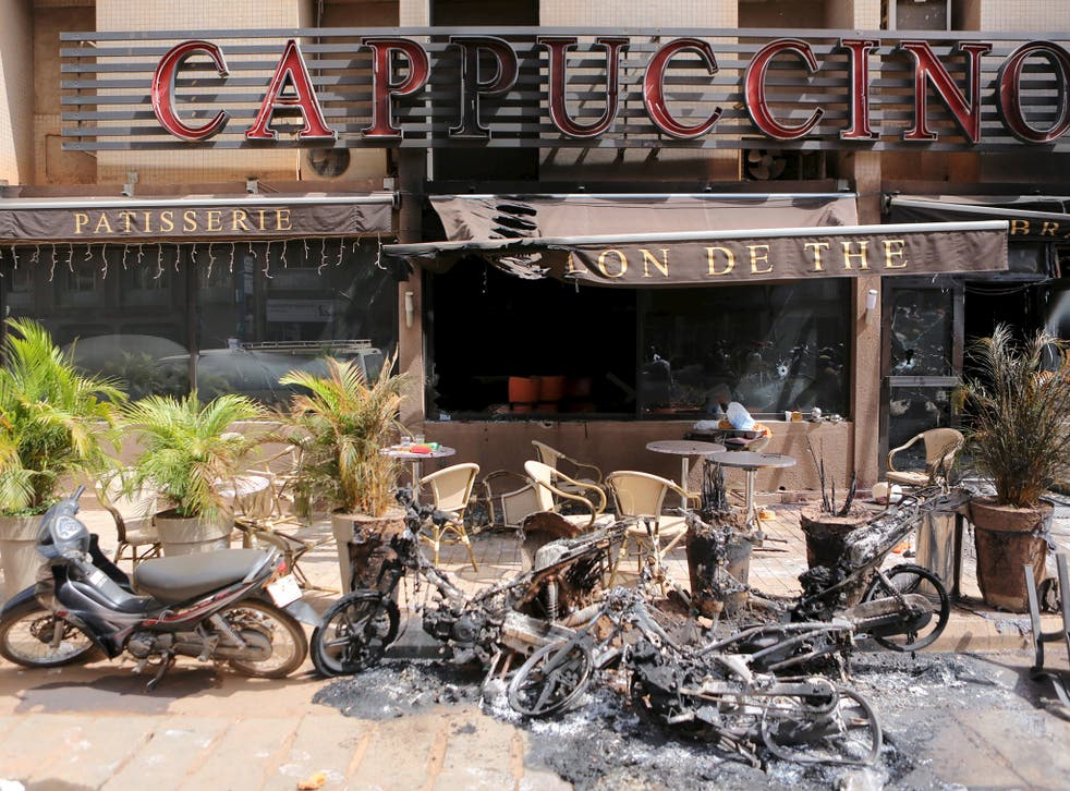 "The burned-out exterior of ""Cappuccino"" restaurant is seen in Ouagadougou, Burkina Faso"