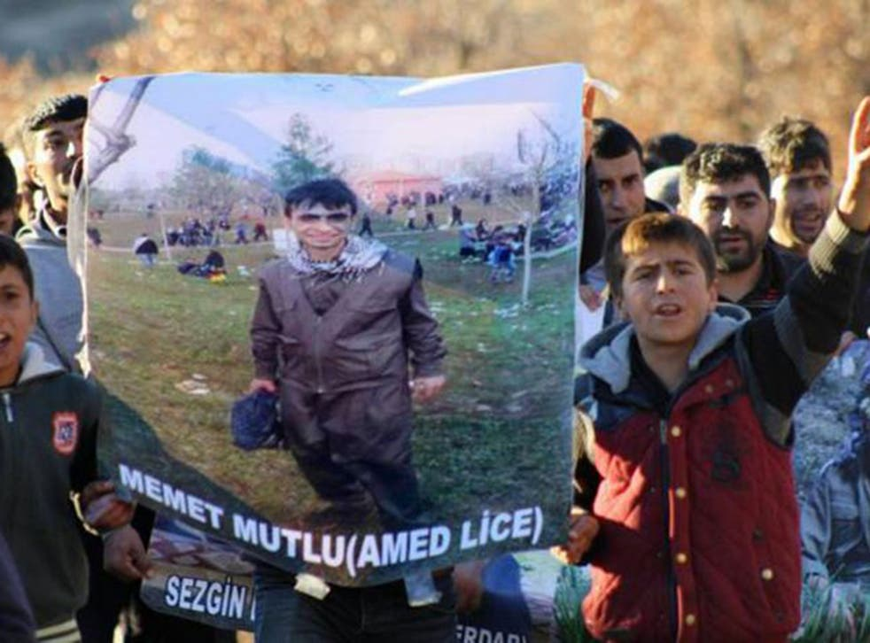 The funeral of 16-year-old Mehmet Mutlu. There are claims that he was shot while his hands were cuffed behind his back