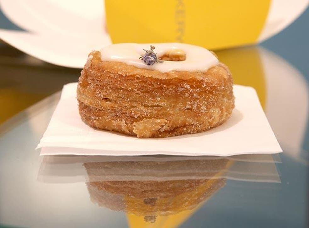 The Cronut is rolled in sugar, filled with cream and topped with glaze