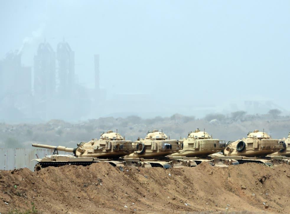 Saudi Arabian tanks wait near the Yemeni border