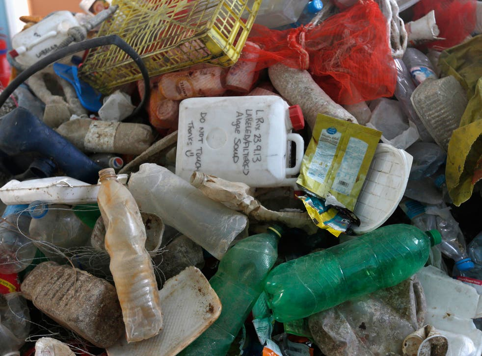 """Plastic waste is seen at the plastic waste exhibition """"Sea, The Last Leg"""" in down town Amman November 19, 2014"""