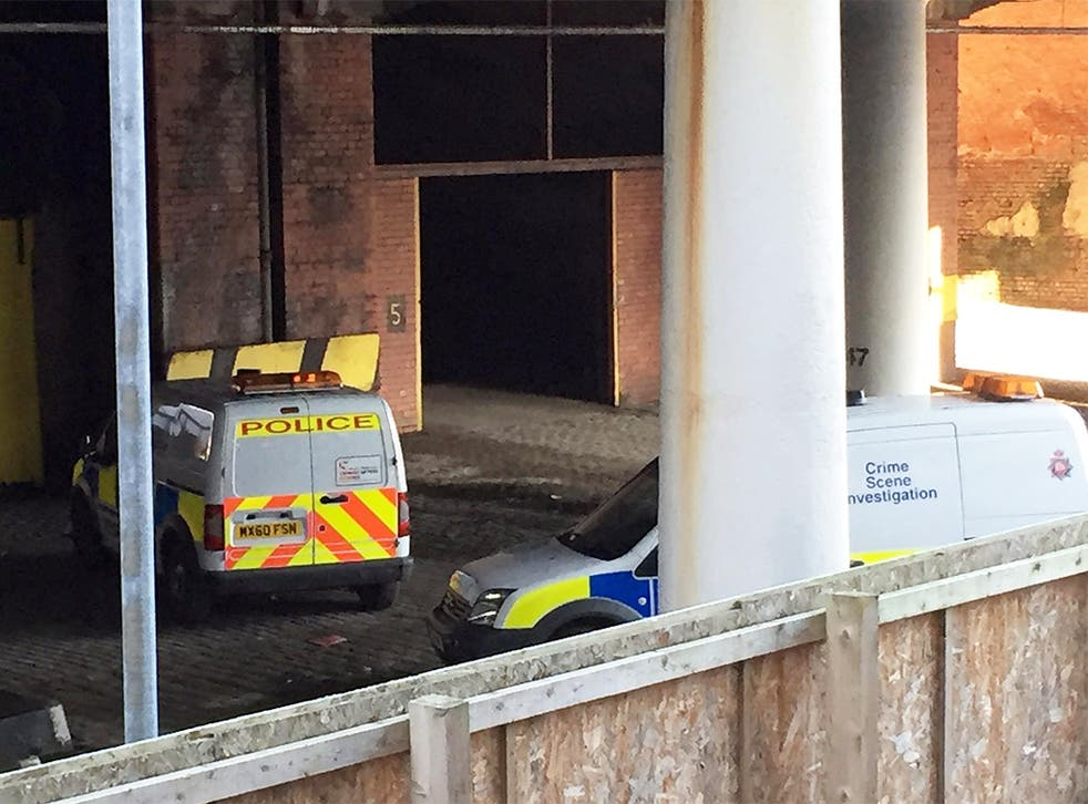 Police cars close to the scene underneath a railway bridge in Salford, Greater Manchester