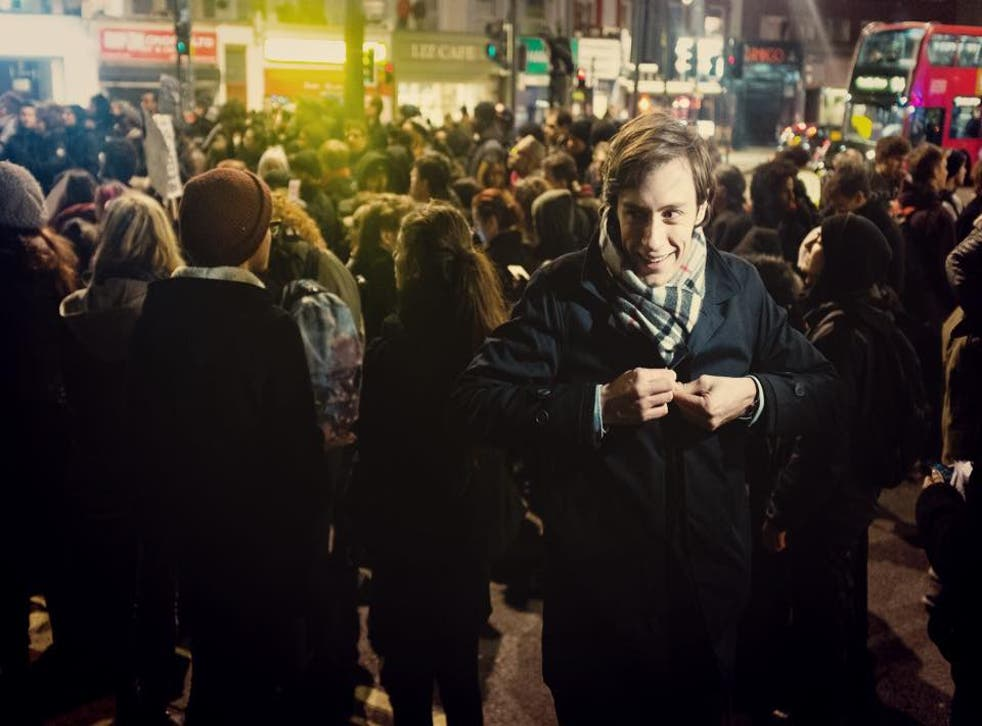 The reporter, pictured, prepares to go live in London