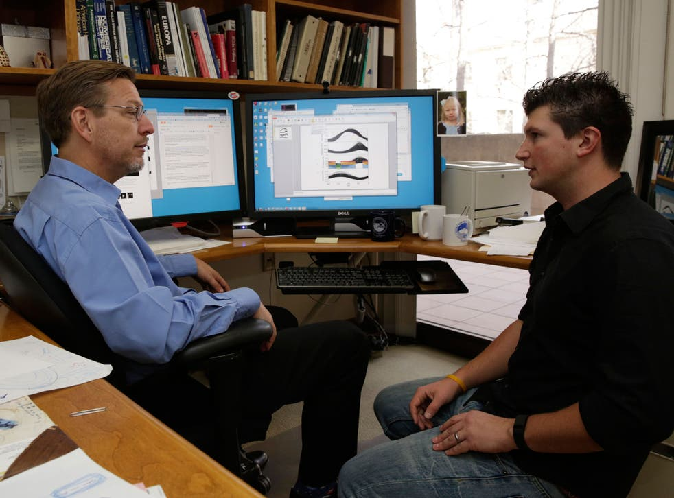 California Institute of Technology scientists, Michael Brown, left, and Konstantin Batygin, Assistant Professor of Planetary Science review their research in Pasadena, California. The scientists reported that they have 'good evidence' for Planet 9, a true ninth planet on the fringes of our solar system