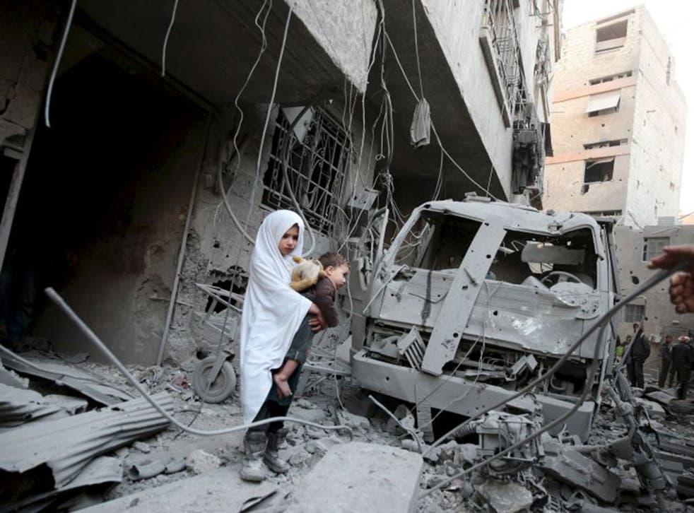 Children amid the ruins of an alleged Russian strike in Douma, near Damascus
