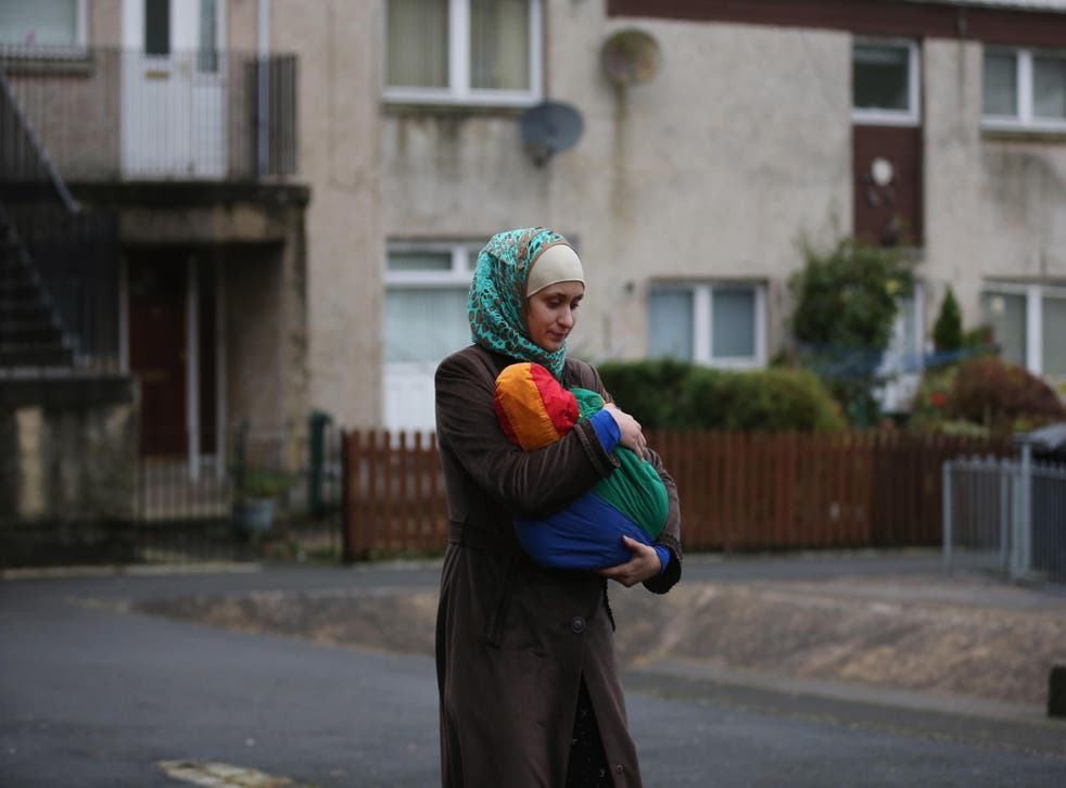 A refugee arrives at her new home in the UK in December, 2015