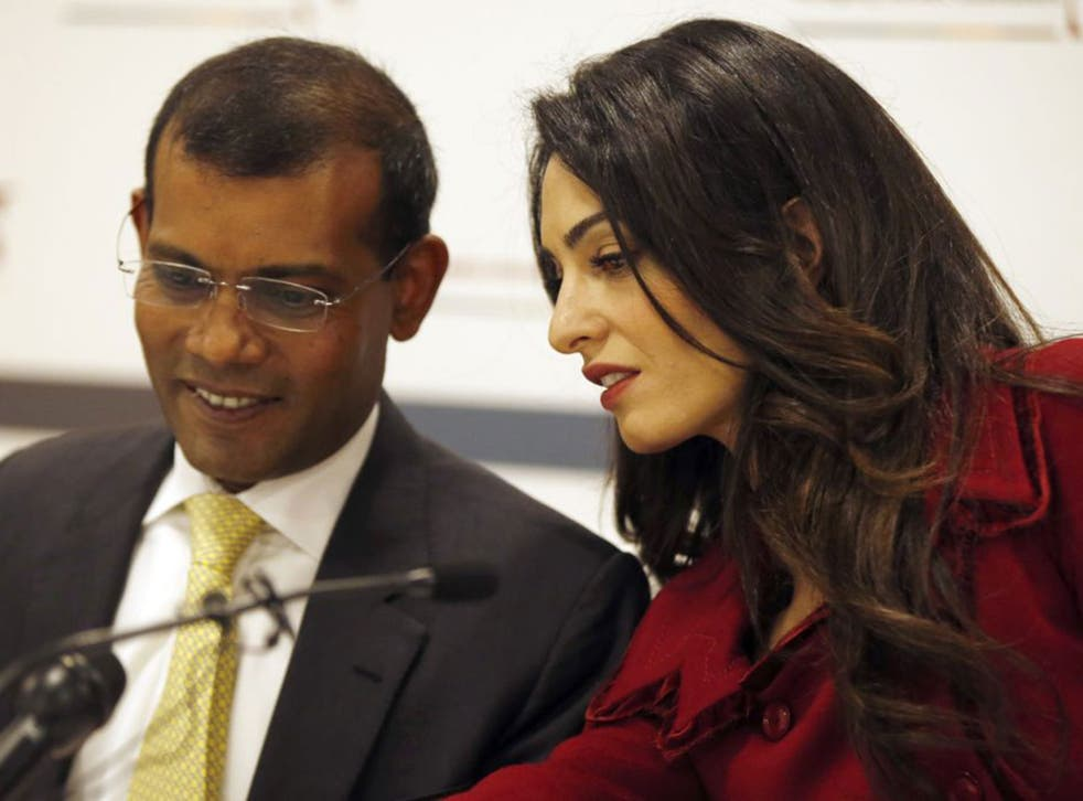Mohamed Nasheed, the jailed former President of the Maldives, pictured with his lawyer Amal Clooney, vows to return to fight for democracy