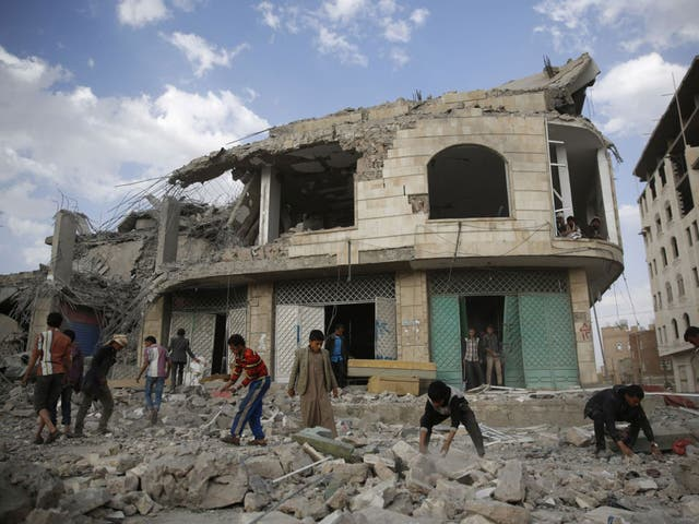 People inspect the rubble of a house destroyed by a Saudi-led airstrike in Sanaa, Yemen. The missile fired by the Saudi-led coalition killed eight people