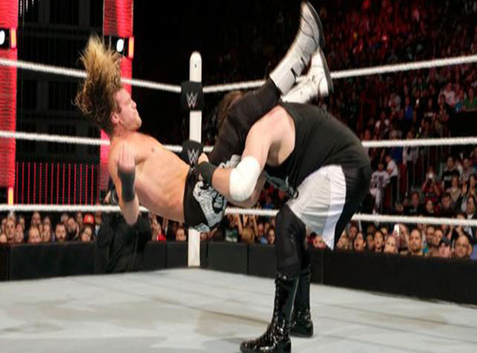 Kevin Owens powerbombs Dolph Ziggler
