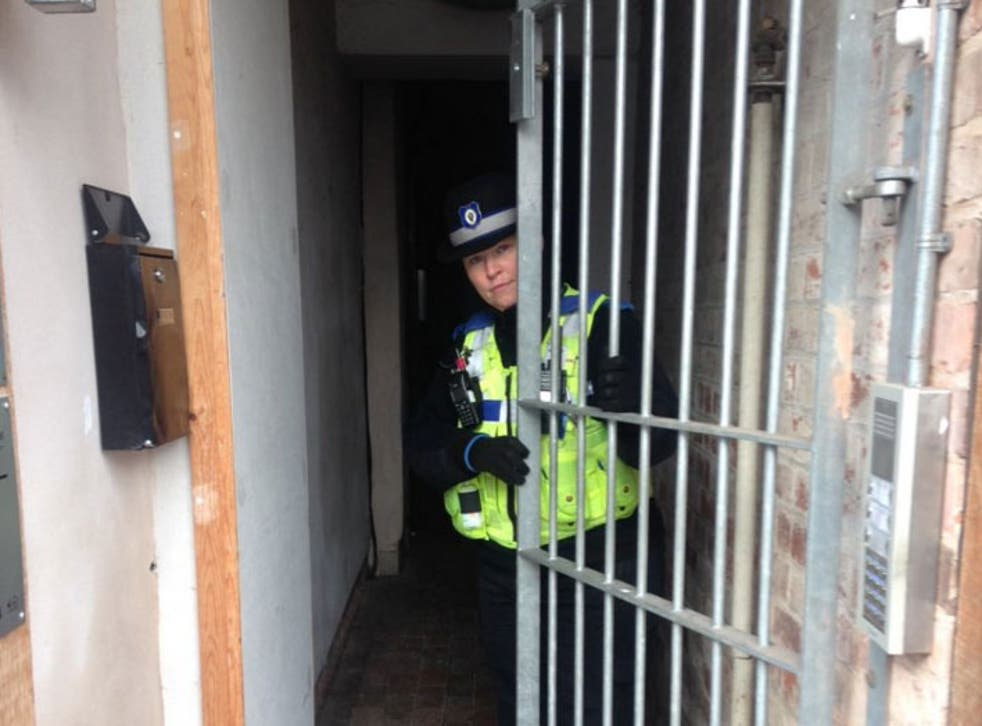A Coventry city police officer showing an unlocked communal gate