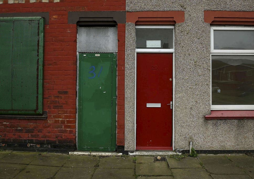 A house with a painted red door is seen on a terraced street in the Gresham & Red doors of asylum seeker housing in Middlesbrough repainted u0027range ...