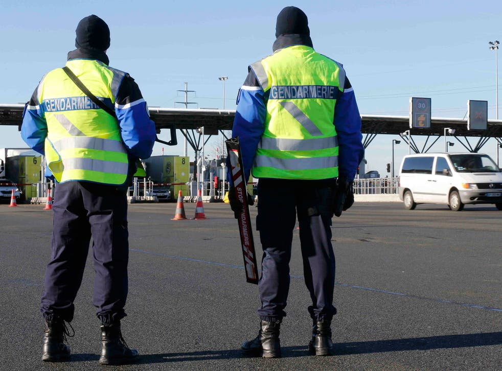 Armed French gendarmes stand next to a toll station as they check vehicles and verify the identity of travellers on the A2 motorway between Paris and Brussels